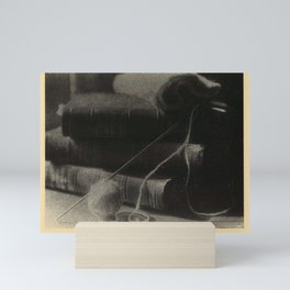 Doris Ulmann  (1882–1934), Stack of 3 books, with yarn and knitting needle Mini Art Print