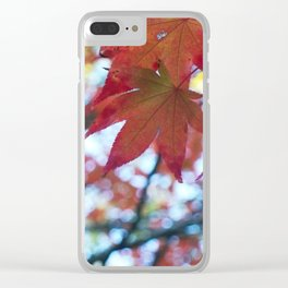 red maple leaves and bokeh Clear iPhone Case