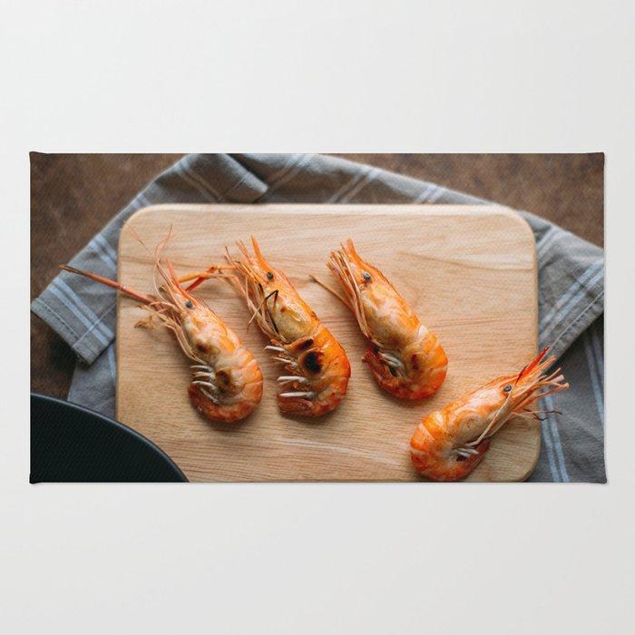Grilled shrimps on wooden board Rug