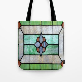 Stained Glass features a picture of a classic stained glass window typically found above a door Tote Bag