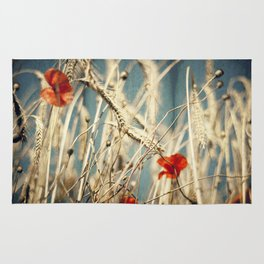 chAos one - red poppies in wheat field Rug