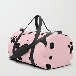 Black dog paw and bones pattern on pink background Duffle Bag