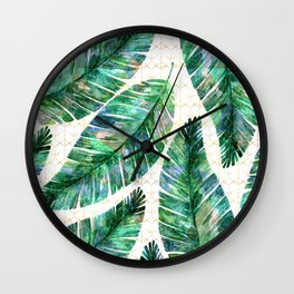 Large tropical leaves on a golden geometric background. Wall Clock