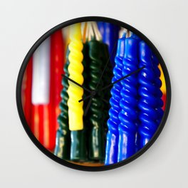the colors of hope in candles Wall Clock