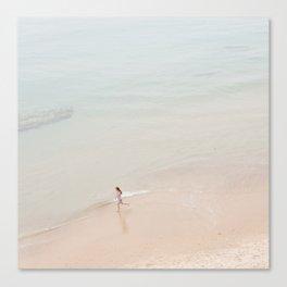 Girl running on the beach Canvas Print