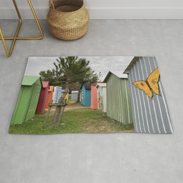colored beach huts Rug