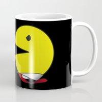 pacman Mugs featuring pacman effect by Capadochio
