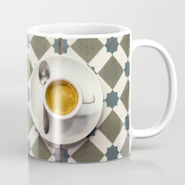 Cup coffee espresso on tile ceramic floor with diamond pattern, top view. Coffee Mug