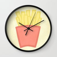 french fries Wall Clocks featuring French Fries by andrialou