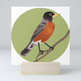 robin on a branch Mini Art Print