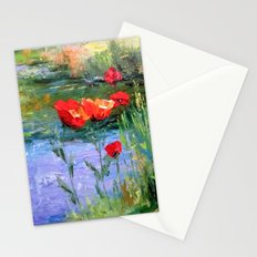 Poppies in a field near a pond Stationery Cards