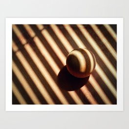 wooden ball covered with the shadow of  sunblinds Art Print