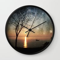 hemingway Wall Clocks featuring The old man and the sea by Paula Belle Flores
