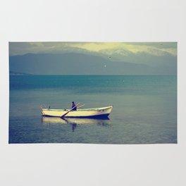 rowing a boat in egirdir lake Rug