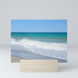 Sandy beach and Mediterranean sea Mini Art Print