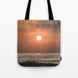Red sunset in the ocean Tote Bag