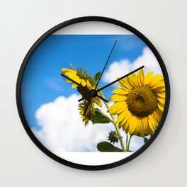 Sunflowers and clouds Wall Clock