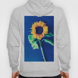 A decorative sunflower on the blue background Hoody