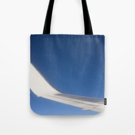 Airplane Wingtip on a blue sky Tote Bag