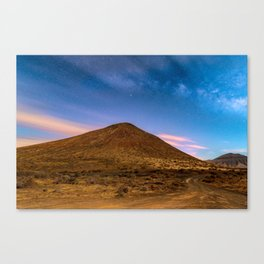 Volcano under night sky Canvas Print