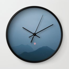 Moonrise in the Hazy Rockies Wall Clock
