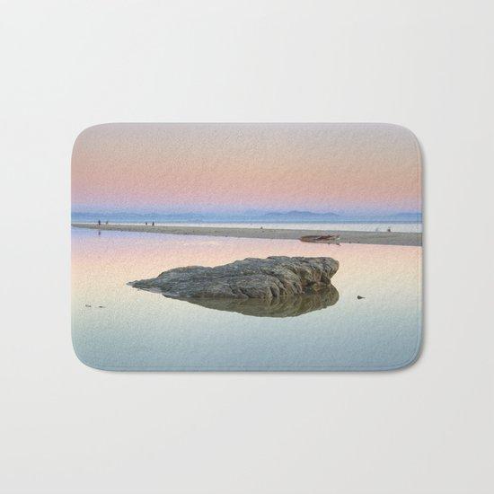 """""""Walking...."""" Pink sunset at the beach. Bath Mat"""