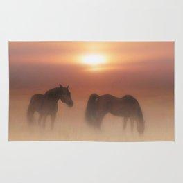 Horses in a misty dawn Rug