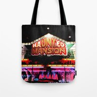 haunted mansion Tote Bags featuring Carnival Haunted Mansion by Teresa Marra