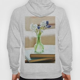 Blue and white flowers in green vase Hoody