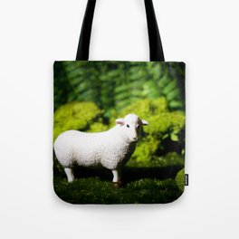 A white sheep in the forest Tote Bag