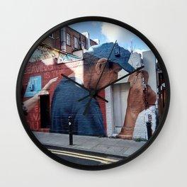 Blue cap. Wall Clock