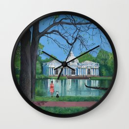 Girl in red dress walking the dog in the park. Wall Clock