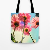 mandie manzano Tote Bags featuring dancing in the sun by RichCaspian