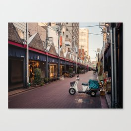 White scooter on the street Canvas Print