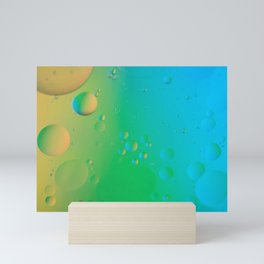 Oil drops in water. Abstract defocused psychedelic pattern image rainbow colored. Abstract backgroun Mini Art Print
