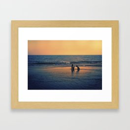 Kids playing by the sea Framed Art Print