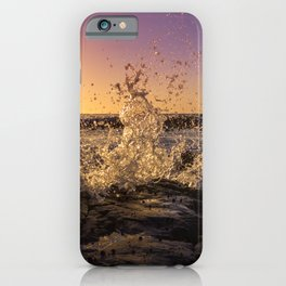 Magical sunset and waves breaking over rocky beach iPhone Case