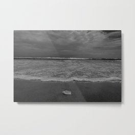 A lonely sea shell in the surf of Assateague Island (black and white) Metal Print