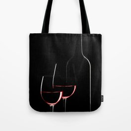 Red wine bottle and two wine glasses on black background on black background Tote Bag