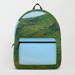green field and green mountain with blue sky Backpack