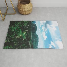 Lush green mountain in valley photo Rug
