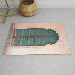 Antique door in India - Teal door, peach wall Rug