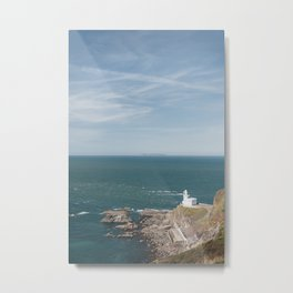 Lighthouse at Hartland Quay with Lundy Island beyond. Devon, UK. Metal Print