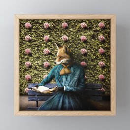 Fiona Fox reading in the garden Framed Mini Art Print