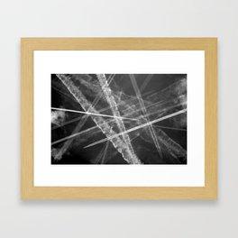 Jet vapour trails in a dark sky Framed Art Print