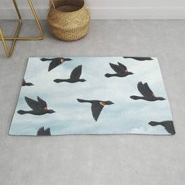 red-winged blackbirds and blue sky Rug