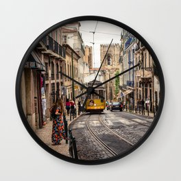 Tram 28 transports tourists through Alfama district in Lisbon, Portugal Wall Clock