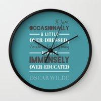 oscar wilde Wall Clocks featuring Oscar Wilde - poster by Katya Sarria