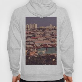 'MODERN BUILDINGS TOWER OVER THE SHANTIES CROWDED ALONG THE MARTIN PENA CANAL' Hoody