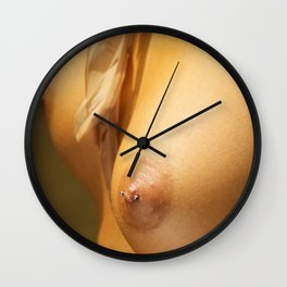 Woman's Pierced Nipples and a Feather Wall Clock
